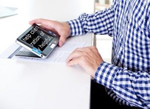 a man reading using a compact 7 HD