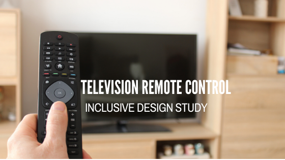 A television remote in a persons hand pointed at a television in the background. Television Remote Control - Inclusive Design Study
